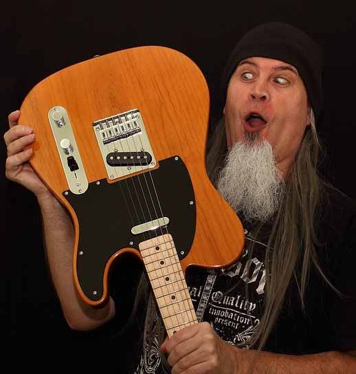 Bearded-Guy-Looking-at-Fender-Telecaster