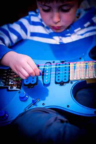 Kid-Playing-Blue-Full-Size-Guitar