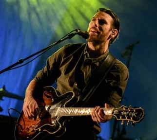 Performer-on-Stage-with-Semi-Hollow-with-Blue-Green-Background