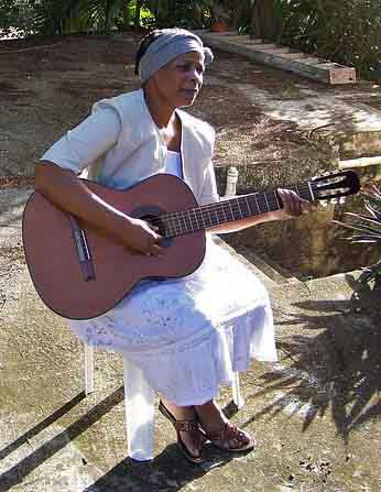 Seated-Woman-Playing-Acoustic-Guitar-Outside