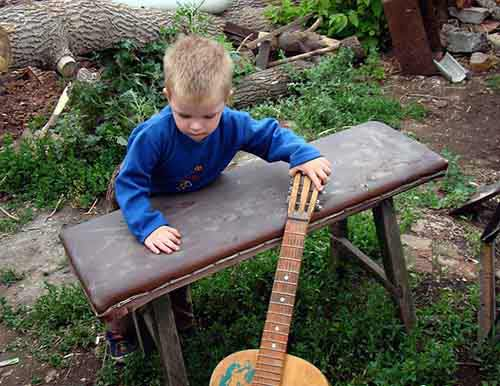 Toddler-Playing-with-Guitar