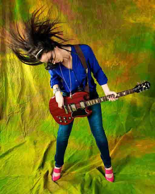 Woman-Guitarist-Headbanging