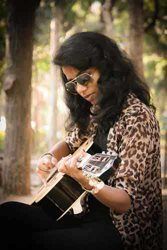 Woman-Wearing-Shades-Playing-Guitar